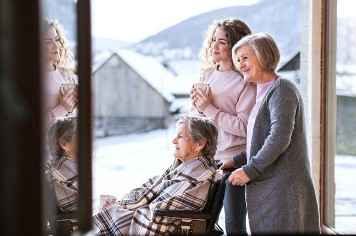 a-teenage-girl-with-mother-and-grandmother-at-P2V7XCA.jpg