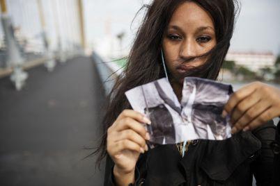 african-woman-sadness-listening-music-tearing-PHK5T3H.jpg