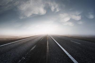asphalt-road-leaving-in-a-bright-light-PP5ME4C-e1563691383825.jpg