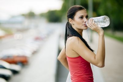 attractive-woman-drinking-water-XRWF4AY.jpg