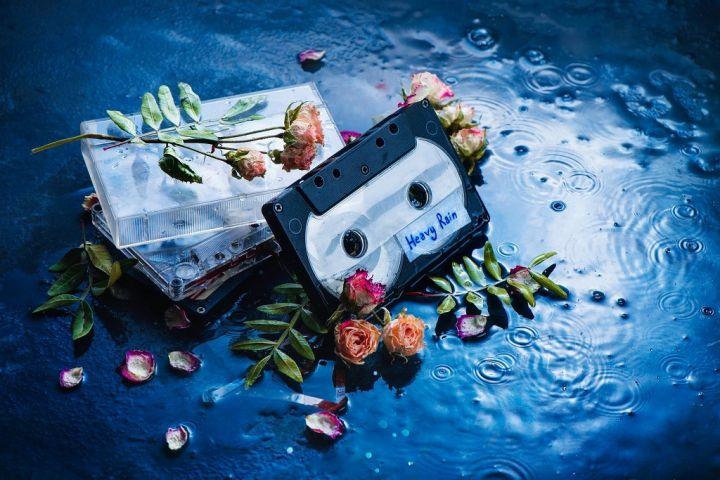 audio-cassette-tape-with-heavy-rain-label-in-a-7AEDFRU.jpg