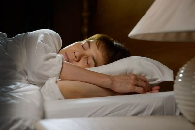 beautiful-woman-sleeping-in-her-bed-at-night-PCRLJCM.jpg