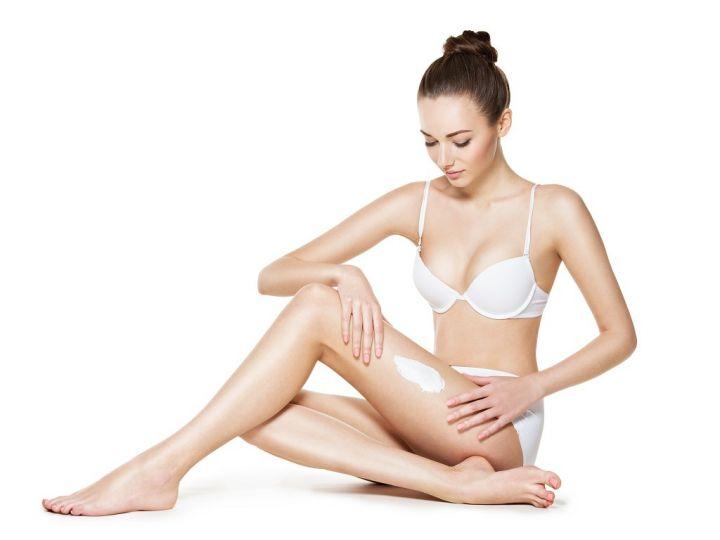 beautiful-young-woman-depilating-legs-by-waxing-PYVN4XR.jpg