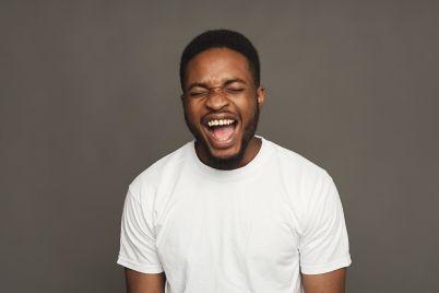 black-man-expressing-anger-feeling-furious-PZMN3FB.jpg