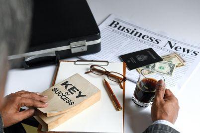 businessman-holding-coffee-and-key-of-success-CHQFBER.jpg