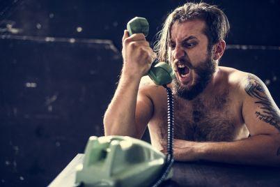 caucasian-topless-man-yelling-over-green-vintage-PJMFPDQ.jpg