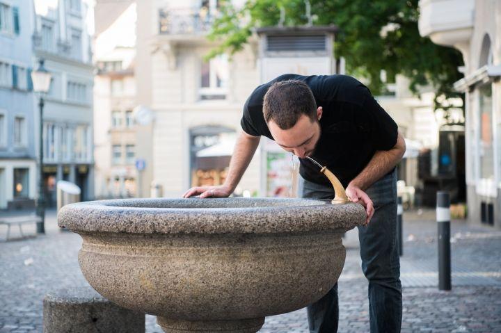 caucasian-young-man-preparing-to-drinking-water-6JDTM35.jpg
