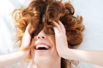 cheerful-woman-with-hairs-on-her-face-PGBGKT7.jpg