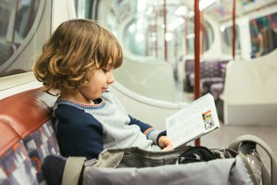 child-traveling-by-subway-PPUJWXV.jpg