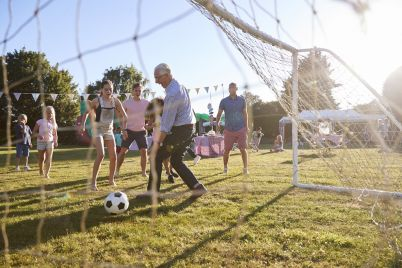 children-playing-football-match-with-father.jpg