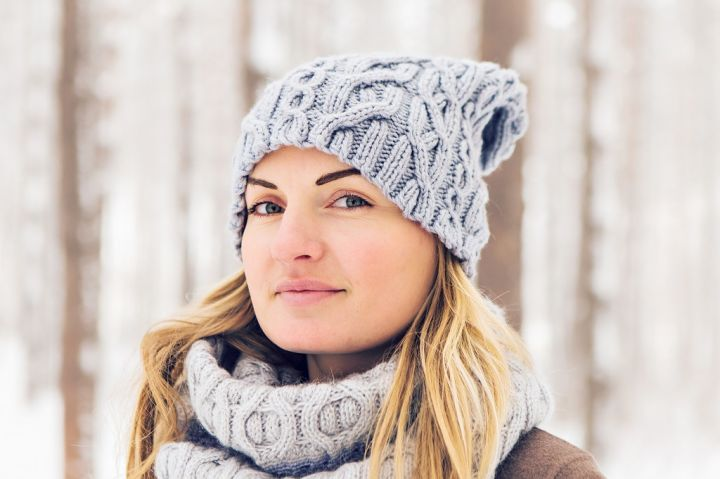 closeup-of-young-woman-in-wintertime-outdoor-snow-PLXBHSE.jpg