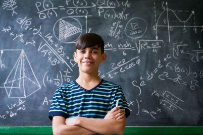 confident-latino-boy-smiling-at-camera-during-PA76XR2.jpg
