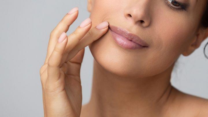 cosmetology-concept-girl-holding-hand-near-lips-8GPMRZU.jpg
