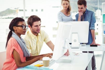 creative-business-team-working-hard-together-on-PL5YJ64.jpg