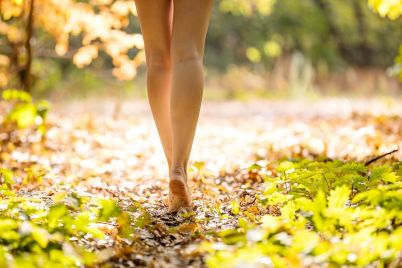 cropped-view-of-beautiful-young-woman-walking-in-PGJTA69.jpg
