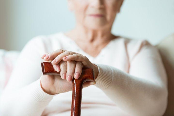 elder-holding-walking-cane-PG8YKBR.jpg
