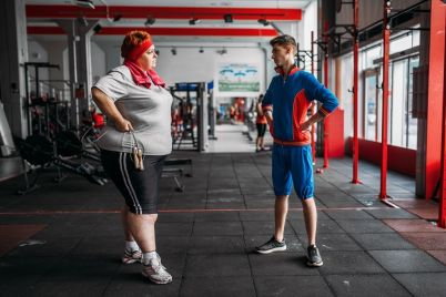 fat-woman-talks-with-instructor-after-exercise-PMJDAN3.jpg