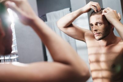 gay-man-worried-for-hair-loss-alopecia-in-home-FUEX5MP.jpg