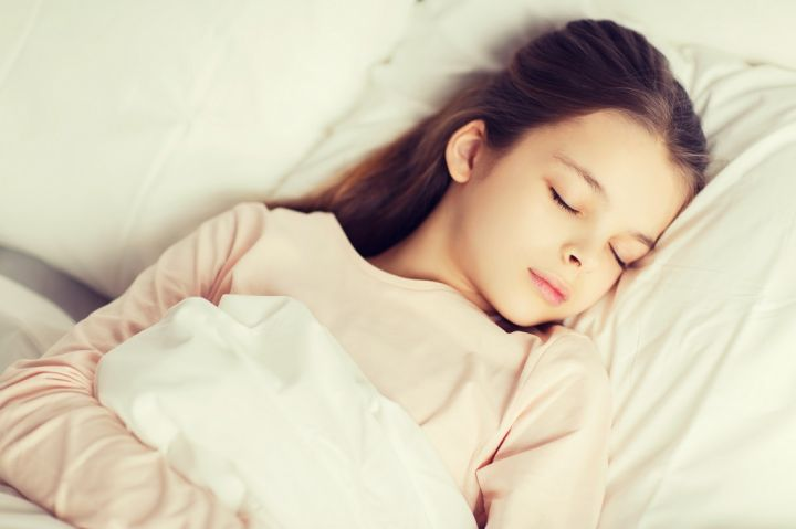 girl-sleeping-in-bed-at-home-PP4SY3S.jpg