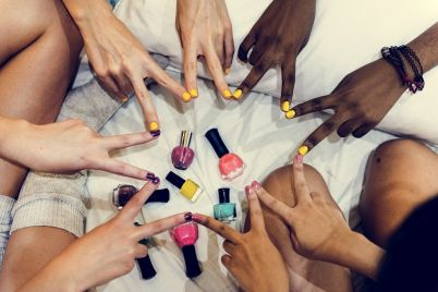 group-of-diverse-women-painting-their-nails-PRUDSPK.jpg