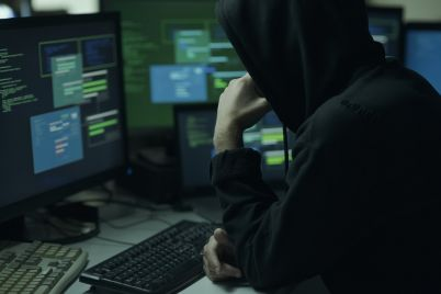 hacker-with-hoodie-working-with-a-computer-V2Q7A84.jpg