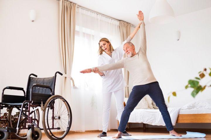 health-visitor-and-senior-man-during-home-visit-PKHU5YE.jpg