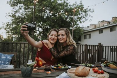 lesbian-couple-taking-a-selfie-B4CTQJL.jpg