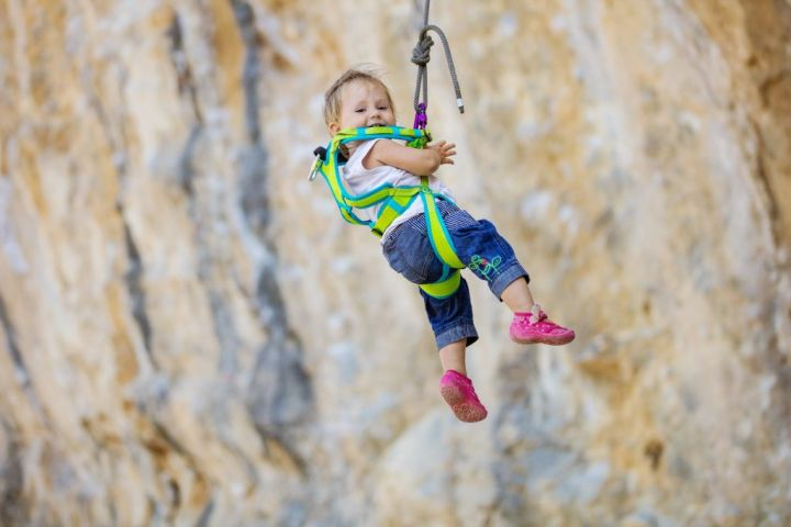 little-girl-in-climbing-gear-hanging-on-rope-PJW7UPQ-e1564494414114.jpg