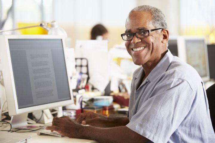 man-working-at-desk-in-busy-creative-office-PK5TA8Y.jpg