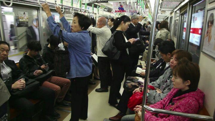 me8919986-2of-japanese-people-commuters-traveling-subway-train-osaka-hd-a0168-poster.jpg