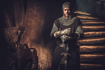 medieval-knight-in-ancient-castle-interior-P5E4FCD.jpg