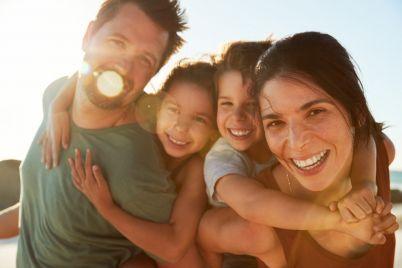 mid-adult-white-parents-piggybacking-their-kids-6M9RNAS-e1563684613490.jpg