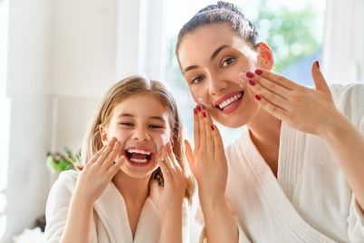 mother-and-daughter-caring-for-skin-F9NSQGT.jpg