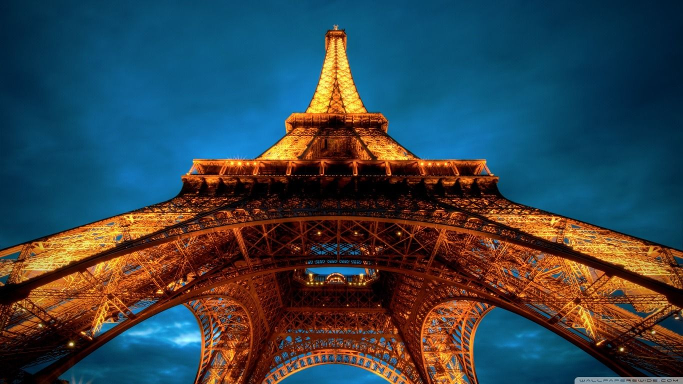 paris_at_night__eiffel_tower_view_from_below-wallpaper-1366x768.jpg