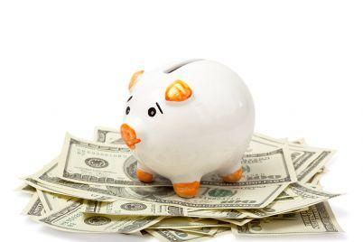 piggy-bank-on-dollars-NGSW73X.jpg