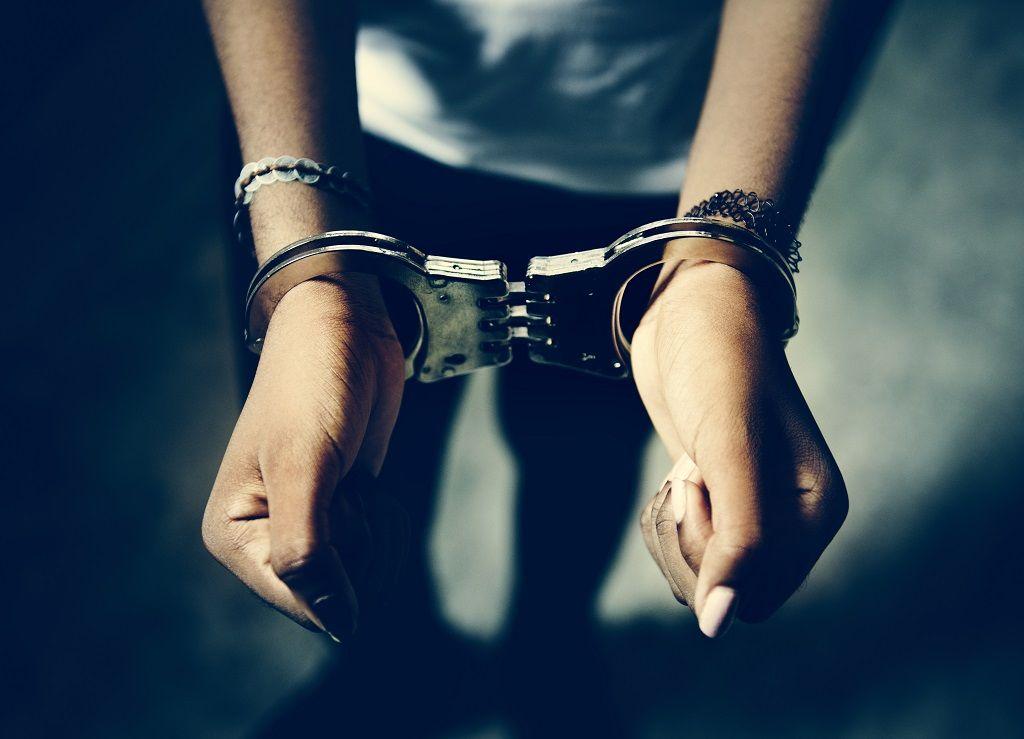 prisoner-with-handcuffs-on-hands.jpg