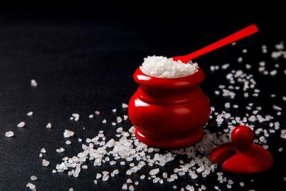 sea-salt-in-wooden-red-salt-shaker-with-spoon-CHDALWH.jpg