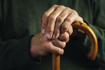 senior-disabled-man-clasping-his-walking-stick-GQC9KVK.jpg