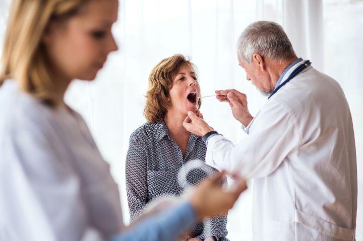 senior-doctor-examining-a-senior-woman-in-office-PV9E56D.jpg