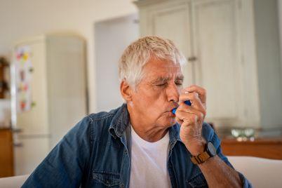 senior-man-using-asthma-pump.jpg