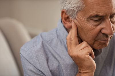 senior-man-with-hearing-problems-68VZQH2.jpg