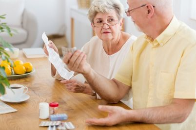 senior-woman-reading-leaflet-of-a-drug-and-AYGJ4DH.jpg