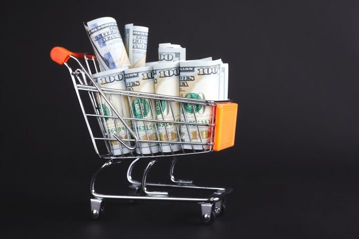 shopping-cart-filled-with-one-hundred-dollar-PWT3K5A.jpg
