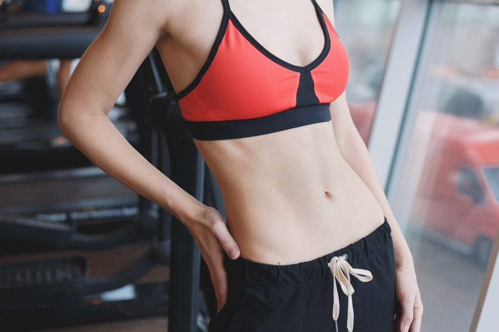 slim-young-woman-body-at-gym-PSLL6Z2.jpg