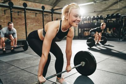 smiling-young-woman-in-a-gym-weightlifting-class-NA5RD9Q.jpg