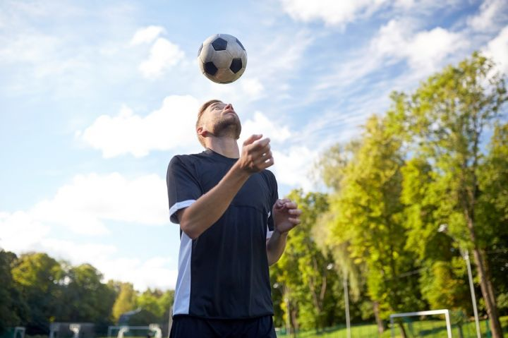 soccer-player-playing-with-ball-on-field-PVCTUM6.jpg
