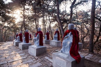 stone-monk-statues-wearing-mantles-at-chinese-P5W9L28.jpg