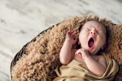 sweet-newborn-baby-yawns-PDLLNCM.jpg