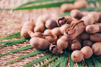 sweet-ripe-tamarind-with-palm-leaves-on-rattan-bac-HK4JBW4.jpg
