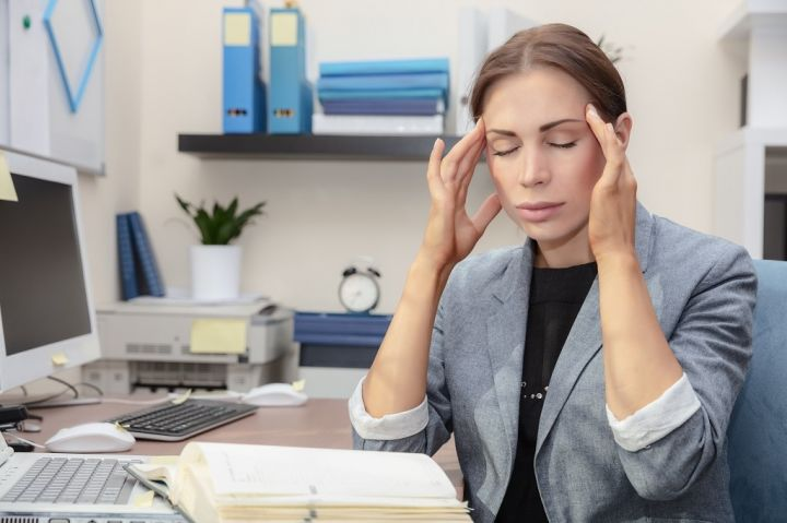 tired-woman-at-work-3FJD859.jpg